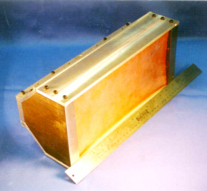 The Linear EFP consists of a shallow copper liner in a boat-tailed box casing, which contains the explosive charge.
